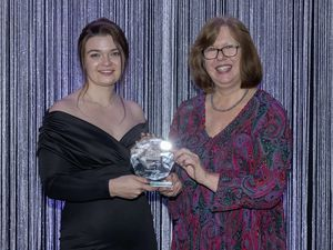 One to Watch winner Francesca Fosey received her reward from director of Publkic health Dr Nicola Brink at the Guernsey ICSA branch annual dinner. (28918886)