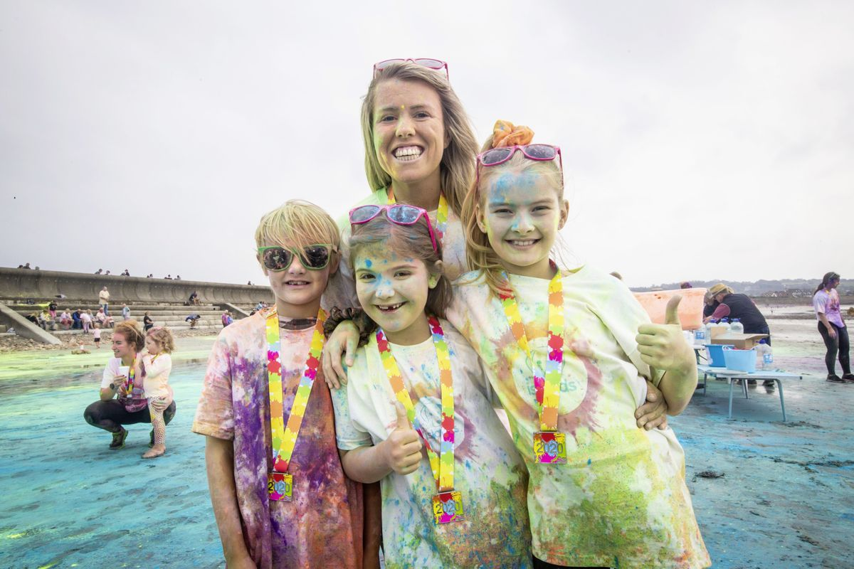 Picture by Sophie Rabey.  19-09-20. Islands Insurance have sponsored a Colour Run on Vazon Beach to help raise money for Guide Dogs for the Blind. L-R Logan Nelson (9), Ava Le Page (7), Brooke Nelson (9) and Sam Jones. (28707336)