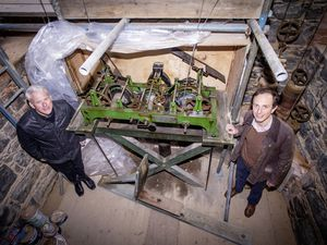 St John's Church vicar, the Rev. Matthew Barrett, left, and clock specialist Ian Lihou alongside the unique weight-driven clock in the church, which Mr Lihou said would outlast us all. (Picture by Sophie Rabey, 29359768)