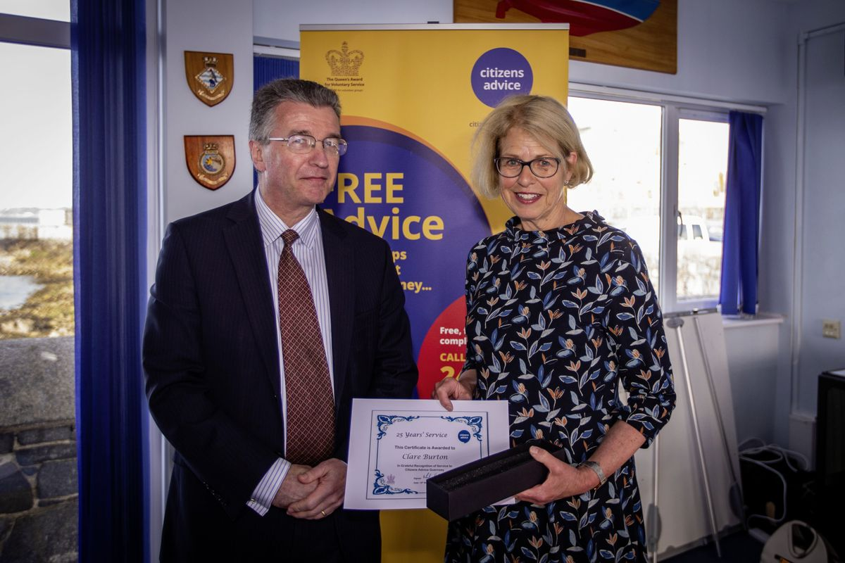 Bailiff Richard McMahon, patron for Citizens Advice, presented Clare Burton with her award for 25 years' of service with the charity. (Picture by Sophie Rabey, 29569921)