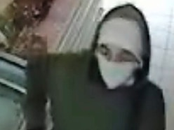 Police hunt for two masked men after garage burglary