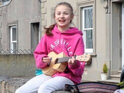 Arabella plays her ukulele for health workers