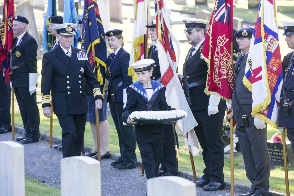 Pic by Adrian Miller 27-09-20 Foulon Cemetery. Remembrance service for H.M.S. Charybdis and H.M.S. Limbourne . Wreath Bearer Cadet Browning 13 of the Sea Cadets leads the Lt Governor Vice Admiral Sir Ian Corder.. (28735063)