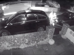 CCTV shows food waste bin being thrown at parked car