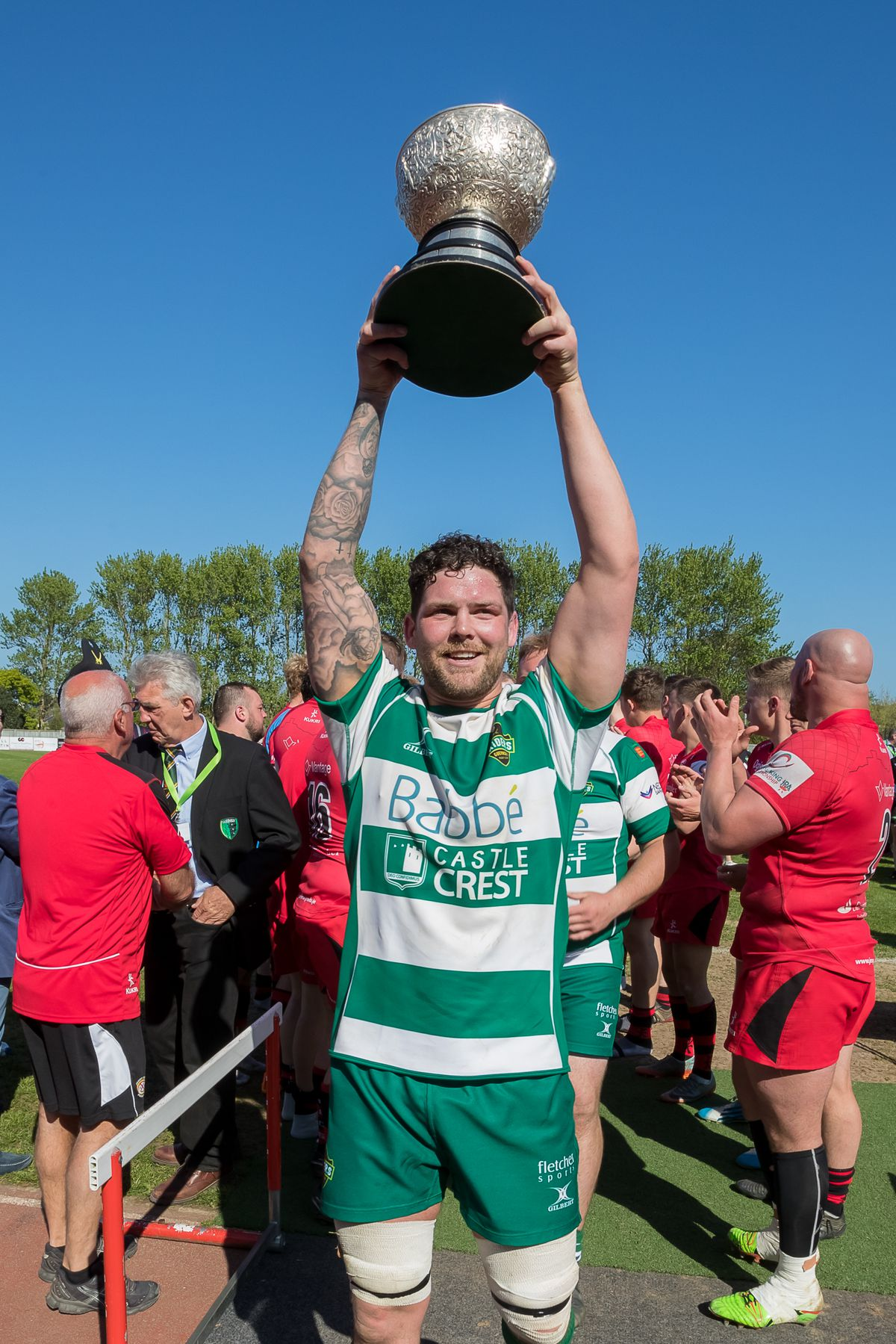 Guernsey Raiders captain Lewis Hillier lifts the Siam Cup the last time the match was played at Footes Lane in May 2018. (Picture by Martin Gray, 29966780)