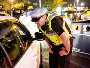 PC Mat Du Port speaking to a driver as Guernsey Police started its annual Christmas campaign to tackle drink-driving. (Picture by Sophie Rabey, 26633799)