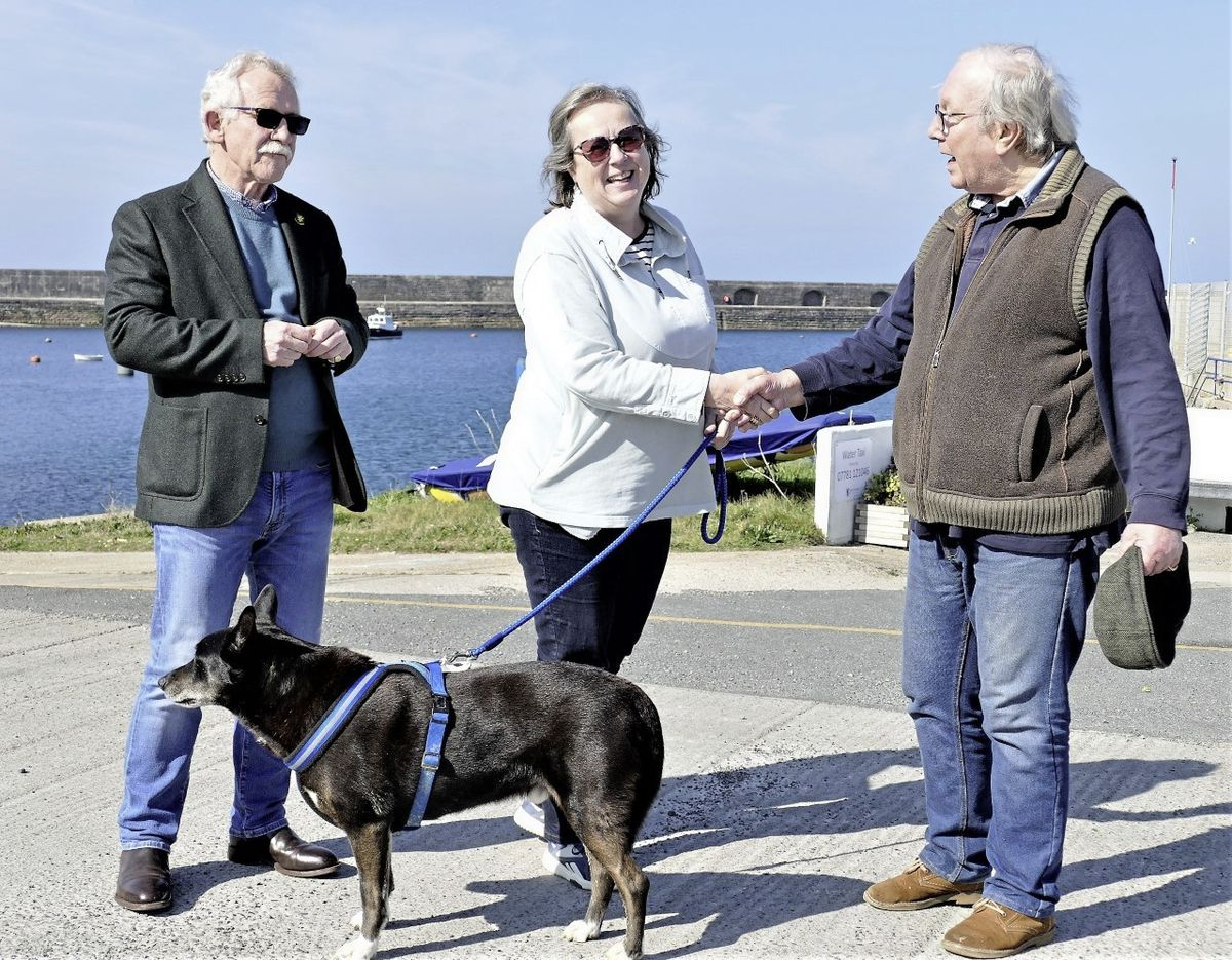 The new chief executive of the States of Alderney Kath Jones arrived in the island by charter boat. She was met by chairman of the Policy & Finance committee Bill Abel, left, and fellow States member Graham McKinley. Picture by David Nash. (29365148)