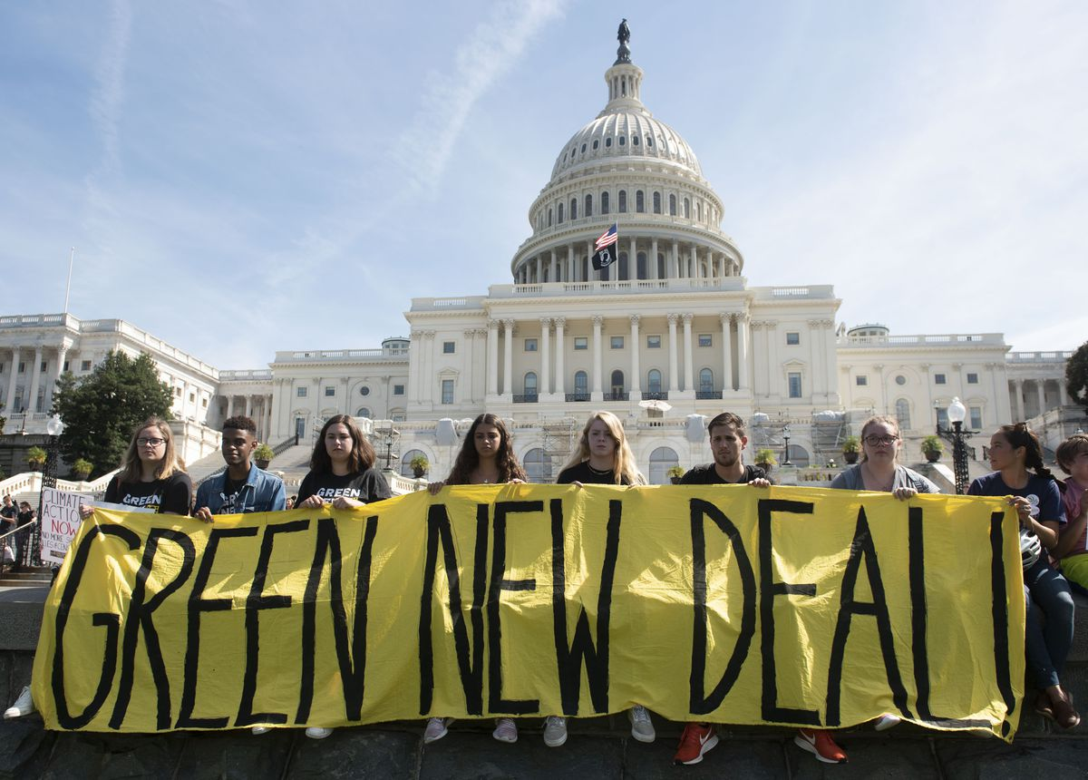 Demonstrators hold a banner on the west front of the Capitol during the Climate Strike protest in Washington. (AP Photo/Kevin Wolf, 25843627)