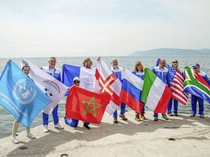 Flying the flag for Guernsey. Sea Donkey Adrian Sarchet with the other eight swimmers from seven countries who completed 60km across Lake Baikal in Russia, but gave up on an attempt to swim up the Angara River to the ancient city of Irkutsk, due to how cold the water was.