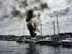 Boat on fire in the QE2 Marina on Sunday 6 June 2021. Picture by Peter Frankland (29625831)