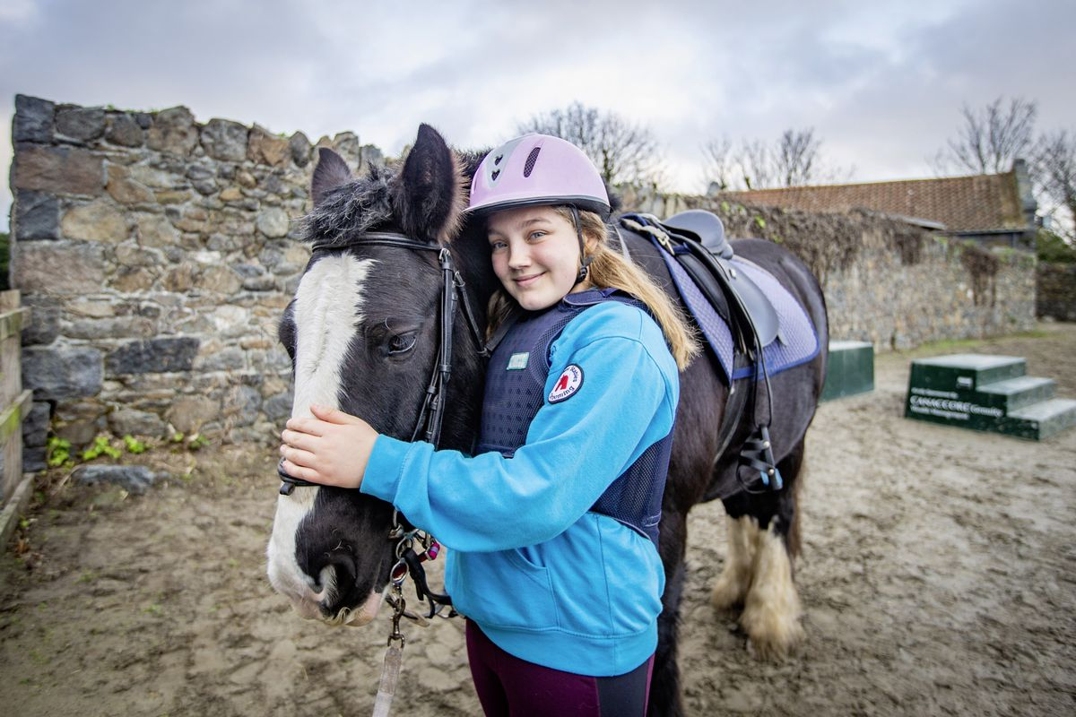 Ada, aged 11, with her horse for the day, Sam. They were one of the combinations taking part in a pre-Christmas mini cross-country event organised by the local group of the Riding for the Disabled Association. (Pictures by Sophie Rabey, 28955593)