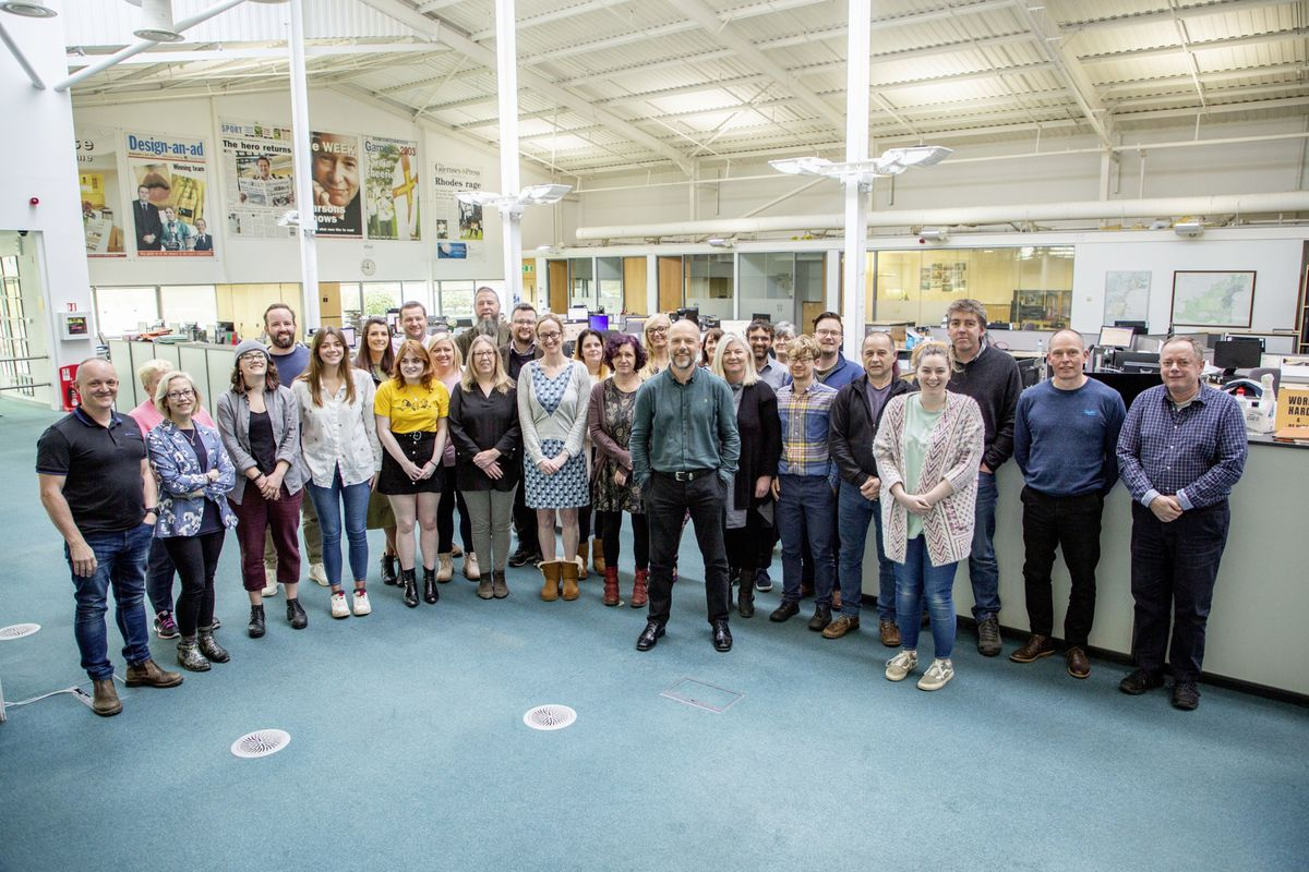 Shaun Green on his last day in the offices of the Guernsey Press surrounded by colleagues from the various departments involved in producing the newspaper. (Picture by Sophie Rabey, 29392781)