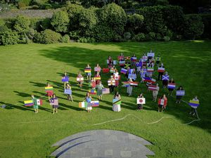Almost 50 Guernsey residents from around the world came together to create a real-life giant version of Women in Public Life's International Women's Day map on the lawns of Government House. (29773547)