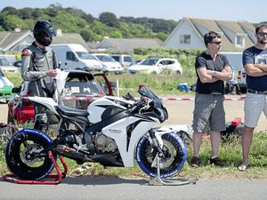 Pic supplied by Andrew Le Poidevin: 02-06-2018 Guernsey Kart & Motor Club Sprint meeting at Vazon coast road. Adam Girard checks the running order in the program before the racing starts. (21626186)