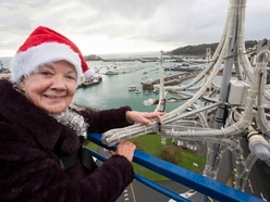 Star on Tree of Joy put in place by Dame Mary