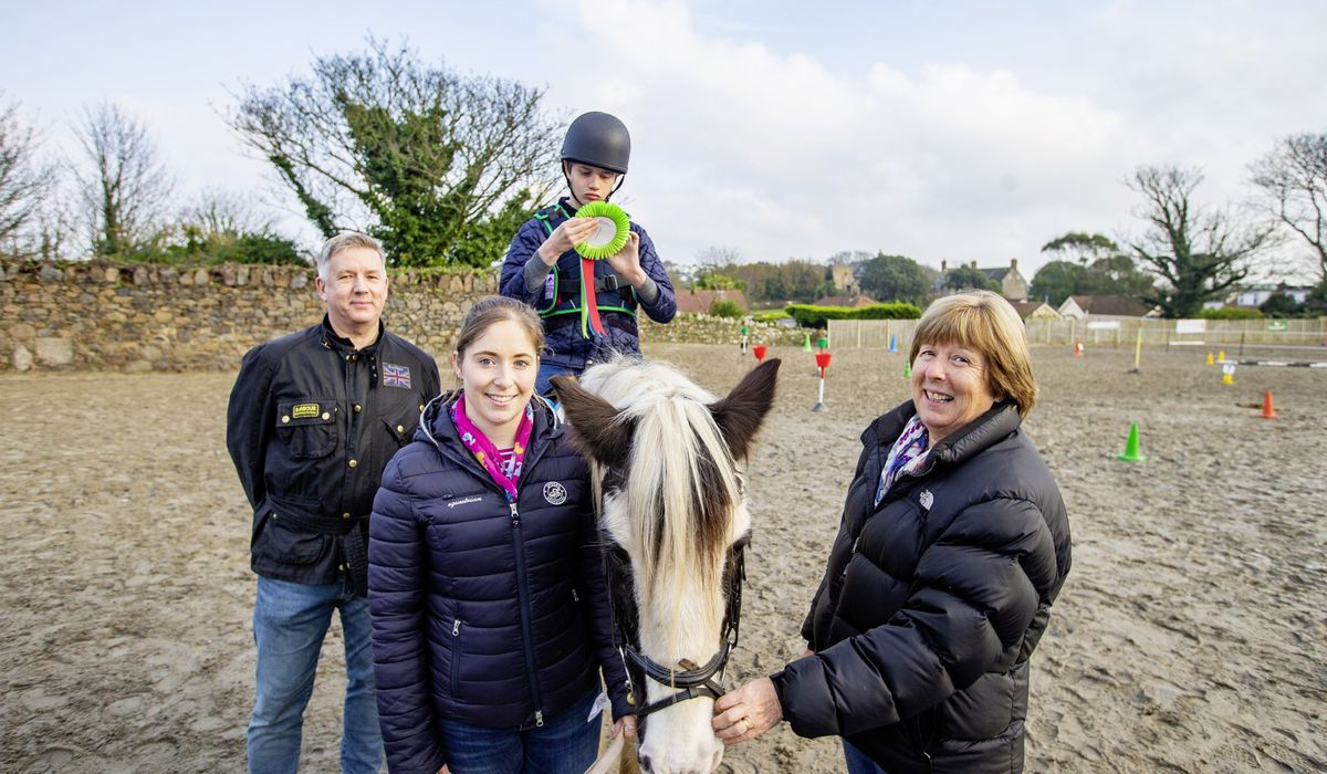Lady Corder, the patron of the local group of the RDA, was on rosette presentation duty yesterday. One of the recipients was Oliver, 14, riding Dan. Also pictured are Rob Jones, managing director of the Guernsey office of event sponsor the Aztec Group, and helper Maddie Wilson.(28955601)