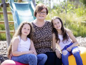 Picture By Peter Frankland. 10-08-21 Dawn Legg has been nominated for carer of the year award for Pride. With her god daughters L-R - Tillie Colmer, 7 and Lottie Colmer, 9.. (29886165)