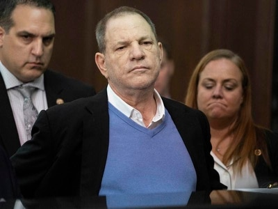 Grinning Harvey Weinstein on one million dollar bail after rape charge
