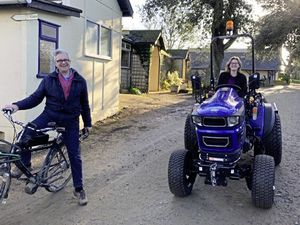 Sibyl Beaumont on the electric tractor, alongside her dad, Seigneur Christopher Beaumont. (Picture courtesy of Kath Jones)