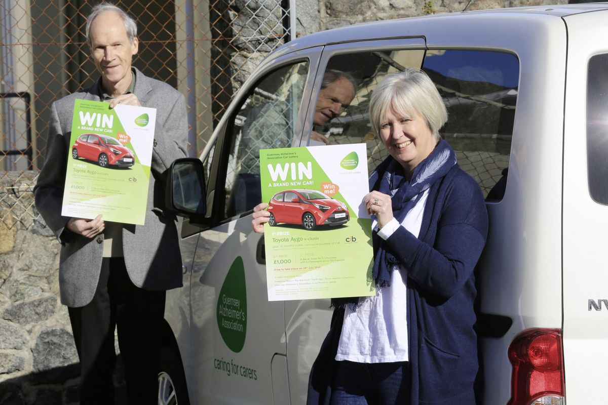 Guernsey Alzheimers Association chairman Stephen Collas and manager Julie Thompson with the posters about the launch of the charity's first ever car lottery. (Picture by Adrian Miller, 29283372)