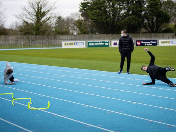 It's a balancing act: Athletics coach Tom Druce overseas training for Josh Allaway, Jordan Kelly, Josh Duke and Alex Falla at Footes Lane.(Picture by Sophie Rabey, 29271100)