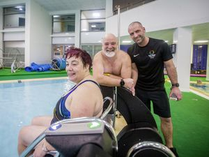 The combination of Beau Sejour duty manager Danny Le Page, right, and open water swimmer Adrian Sarchet, who is known as the Sea Donkey, conceived and raised much of the money for the PoolPod system, which allows swimmers such as Guernsey Disability Swimming member Sandra Robilliard to enter the pool in safety and with dignity. It can be used by any swimmer with mobility problems or parents with babes in arms. (Pictures by Sophie Rabey, 29113797)