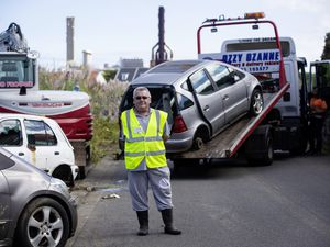 Douzenier Brad Le Flock, who has worked for a long time to get the vehicles removed from Saltpans Road, was on site yesterday as Ozzy Ozanne's Recoveries and Transport Solutions removed the abandoned vehicles. (Picture by Peter Frankland, 29994596)