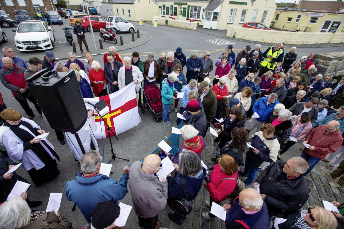 There was a good attendance at the Cobo slipway service to bless the Grosse Rocque flag, which was led by Castel rector Rev Scott Lamb.(Pictures by Peter Frankland, 29528189)