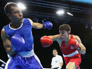 Guernsey's first ever Commonwealth Games boxer Billy Le Poullain goes on the attack against Pakistan's Gul Zaib in Gold Coast.