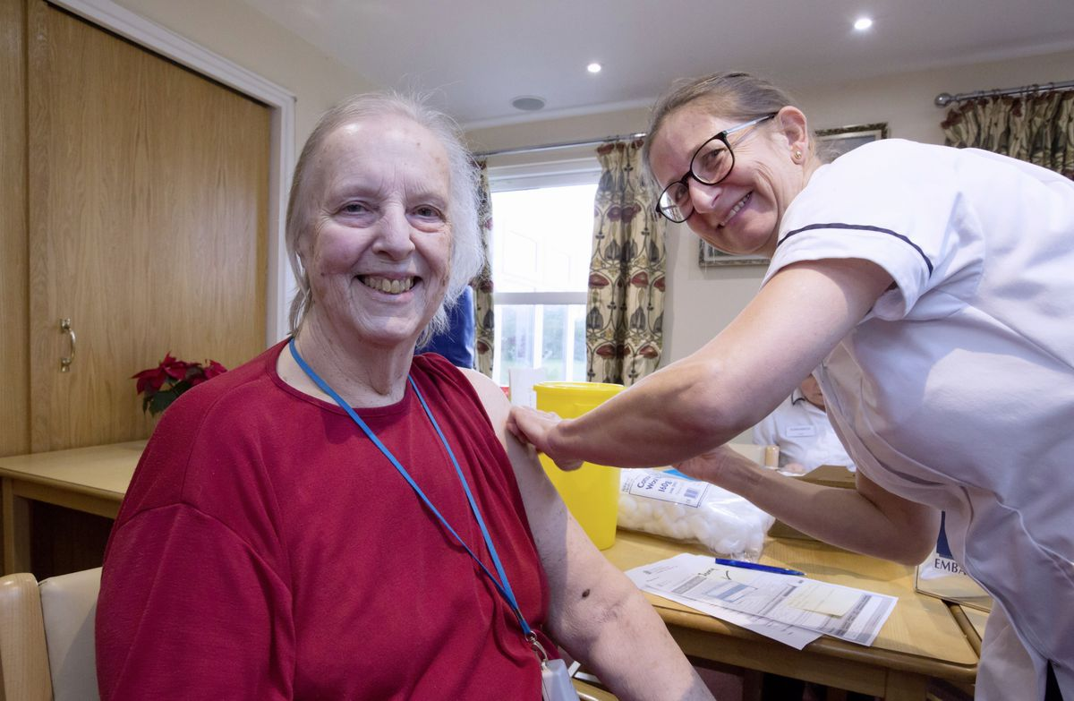 Chateau des Tielles resident Jennie Jouhning is the first one to get her jab by Sister Debbie Duquemin, lead nurse Island Health. (Picture by Adrian Miller, 29106196)