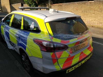 Officers see funny side as pranksters wrap police car in cling film