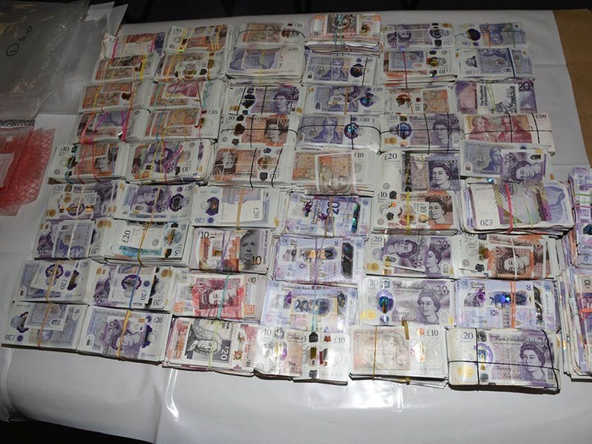 Jail for woman stopped at Heathrow with suitcases full of cash