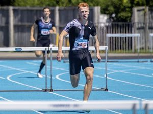 Picture by Sophie Rabey.  12-07-20. Guernsey Athletics Track & Field Meet 2 at Footes Lane.  300m Hurdles.  .Alastair Chalmers leads.. (28459356)