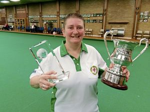 Alison Merrien with her IIBC World Championships women's singles trophy after she beat Devon Cooper in the final in Merthyr Tydfil, 12-04-19.