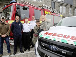 Pic by Adrian Miller 12-12-18   Guernsey Fire Station Money hand over to charity raised from open day.    L>R Peter Saunders firefighter and a member of Cliff Rescue team, Jason James treasurer of Firefighters charity, chief fire officer Jon Le Page, Gary Van der Linden station officer and Helen O'Hara treasurer of Guernsey Down Syndrome Group with her daughter Sibbie O'Hara 2. (23362339)