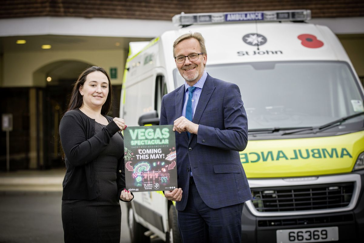Nikki Harrison, chief executive officer of St John Ambulance, and Jonathan Squire, manager of St Pierre Park Hotel, holding a promotional poster for the Vegas fundraiser. (Picture by Sophie Rabey, 29369168)