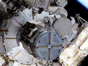 Spacewalking astronauts boost station's solar power