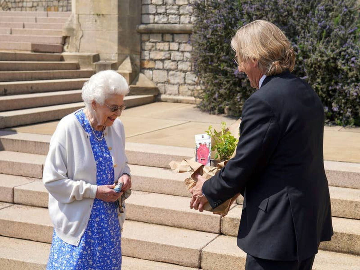 Queen marks Philip's 100th birthday by planting rose named after him