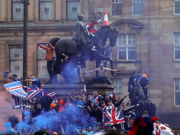 Three police injured and 20 arrested as Rangers fans celebrate in Glasgow