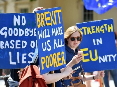 Fight over Brexit continues as thousands take to streets two years after vote