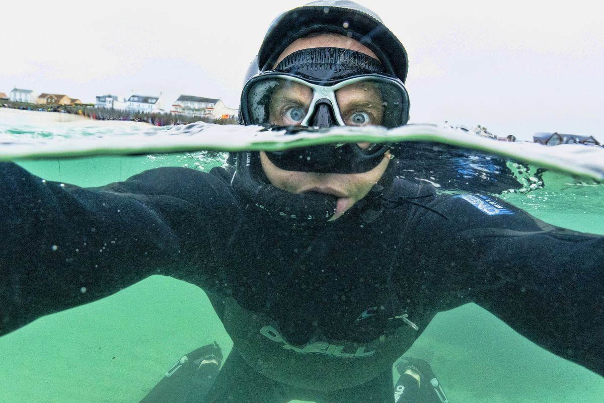 Photographer Peter Frankland donned a 6mm hooded wetsuit for this swim selfie. (29059369)