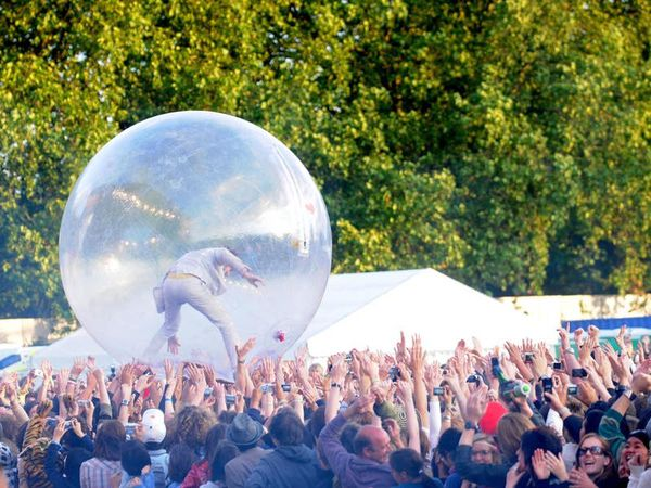 Flaming Lips stage concert with audience members inside giant bubbles