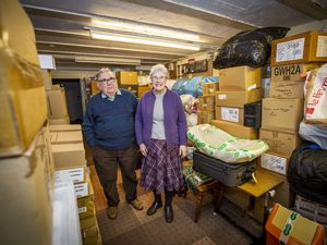 Wilf and Patricia Holland with the aid which will be moved to new storage. (Picture by Sophie Rabey, 29495511)