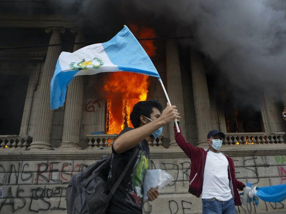 Protesters torch Guatemala's Congress building amid unrest