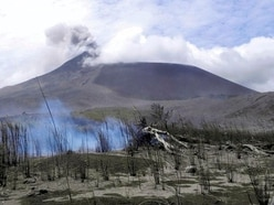 Indonesian volcano erupts sending thick ash into sky