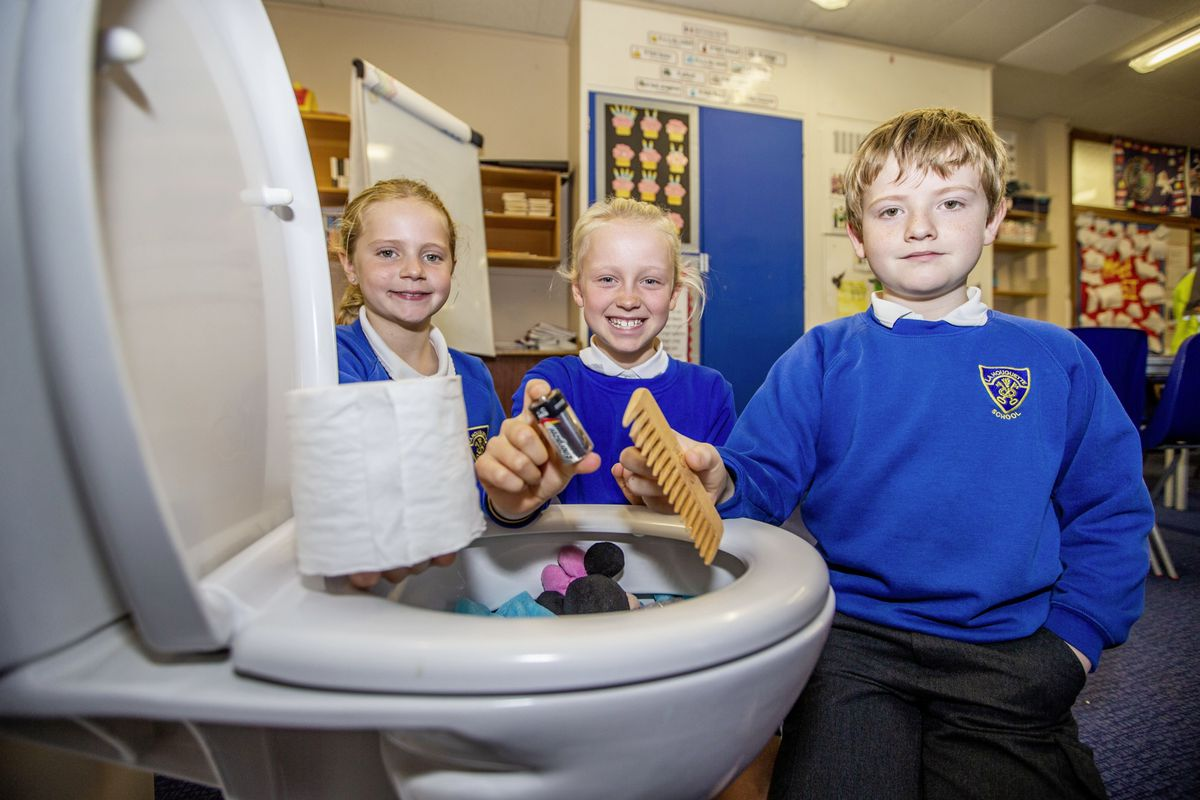 Guernsey Water put on a special lesson at La Houguette School to teach pupils the importance of wastewater and what should and shouldn't be put down a toilet. The centrepiece of the lesson was a fake toilet full of things that should/shouldn't be put in it. The pupils pictured learning the rights and wrongs are, left to right, Maisie Johns and Indi Warren, both 9, and George Atkins, 10. (Pictures by Sophie Rabey, 28950975)