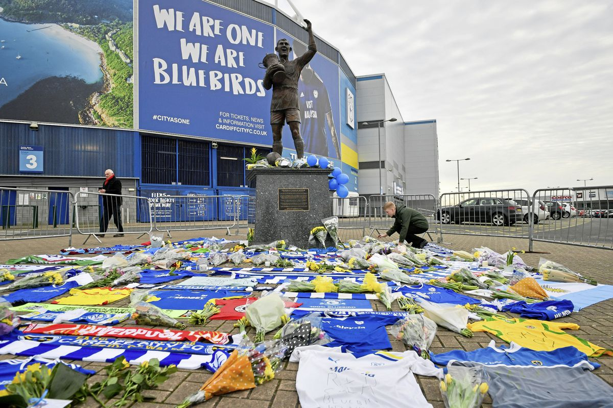 Flowers and tributes left by the statue of Cardiff City footballer Frederick Charles Keenor outside Cardiff City Football Club after the plane with new signing Emiliano Sala on board went missing over the English Channel two years ago. Ben Birchall/PA Wire. (29145087)