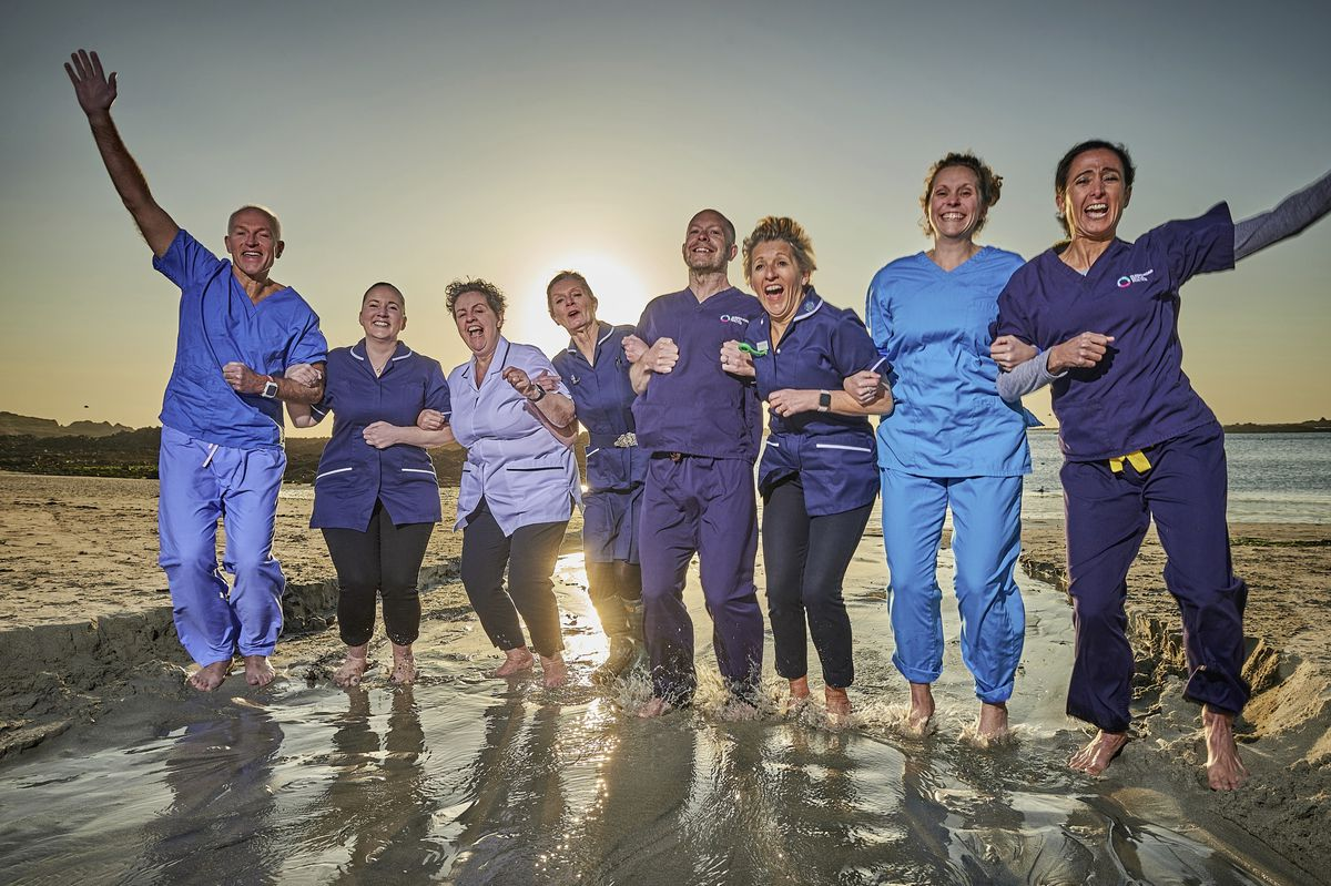 Leading the way in jumping in the sea are these medical staff, left to right, Dr Hamish Duncan, Hannah Tetlow, Ellen Bain, Carol Crowson, Dr Piers Mitchell, Tracy Paul, Dr Joanna Daish and Dr Marta Vila. (Picture by John de Garis)