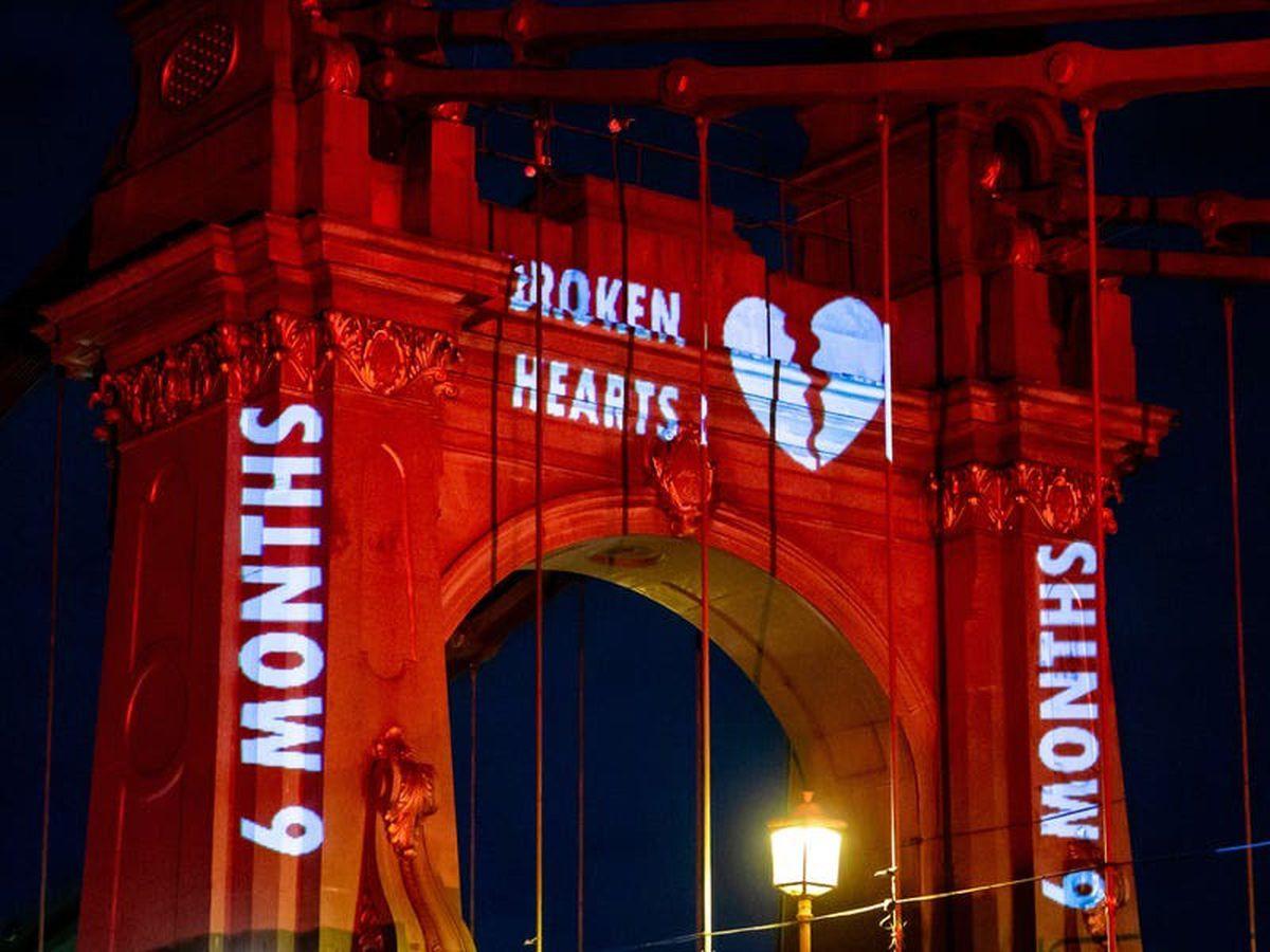 Hammersmith Bridge illuminated red in Valentine's Day message to Government