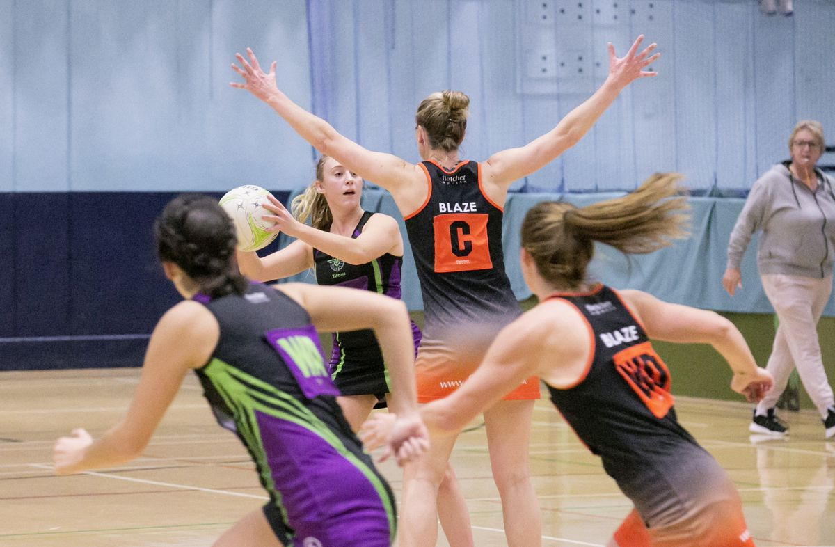 T&T Purple's player-of-the-match Amy Le Tocq takes a centre pass against Blaze A at Beau Sejour. (Picture by Adrian Miller, 28897733)